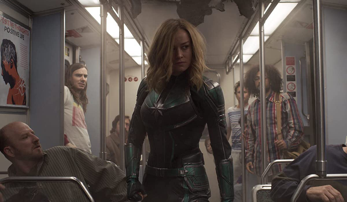 Brie Larson as Captain Marvel on bus in 2019 movie