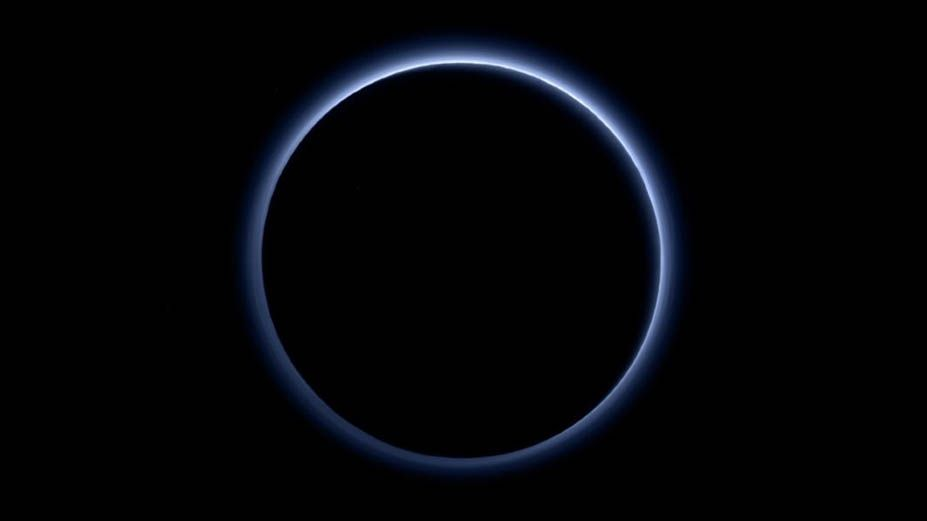 Pluto's atmosphere gets its blue haze from icy organic compounds, study suggests
