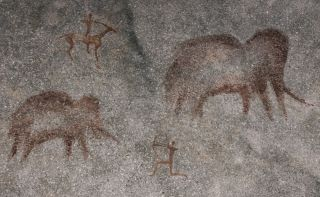 A rock painting, which is not part of the current study, showing mammoth hunters.