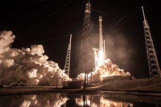 A launchpad photo provided by SpaceX shows the Falcon 9 carrying Zuma