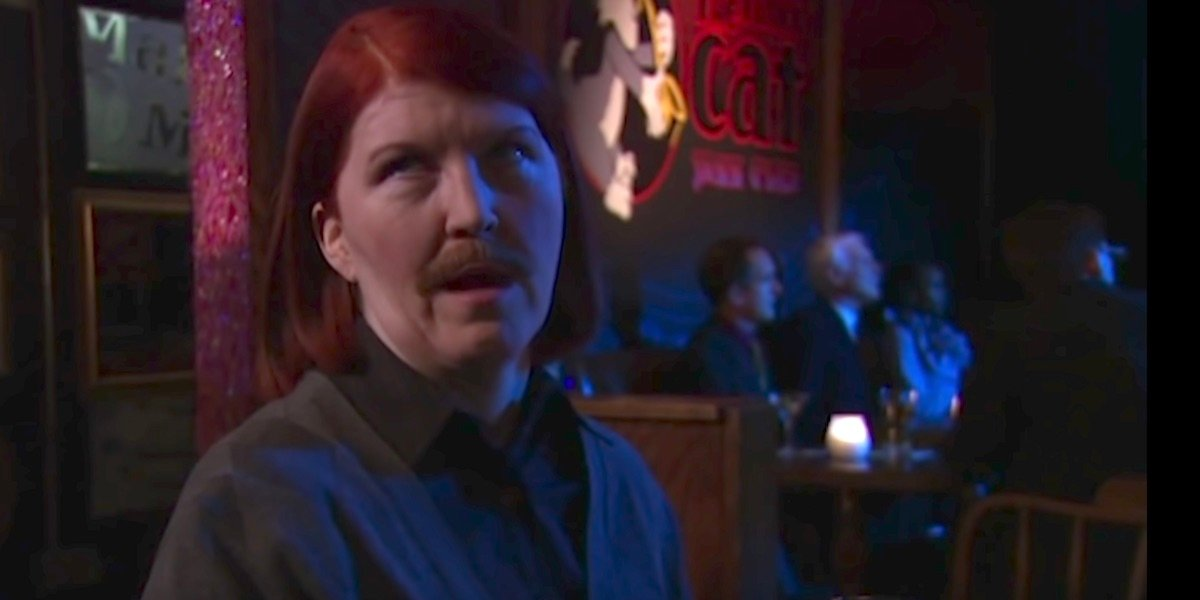 Meredith with a mustache in Threat Level Midnight