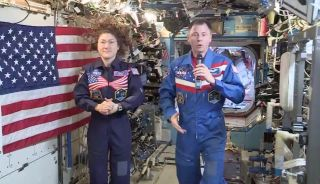NASA astronauts Christina Koch and Nick Hague wish Americans a happy Fourth of July from the International Space Station.