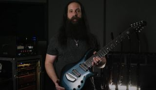 John Petrucci with his new signature Ernie Ball Music Man Majesty 8 guitar