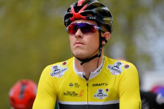 MARTIGNY SWITZERLAND APRIL 28 Rohan Dennis of Australia and Team INEOS Grenadiers Yellow Leader Jersey at start during the 74th Tour De Romandie 2021 Stage 1 a 1681km stage from Aigle to Martigny TDR2021 TDRnonstop UCIworldtour on April 28 2021 in Martigny Switzerland Photo by Luc ClaessenGetty Images