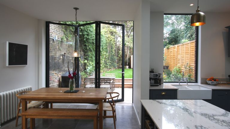 How to protect your home: open plan kitchen extension with stylish bi fold doors