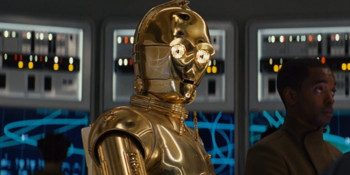 Star Wars: The Rise of Skywalker C3PO sitting with red eyes on a repair table
