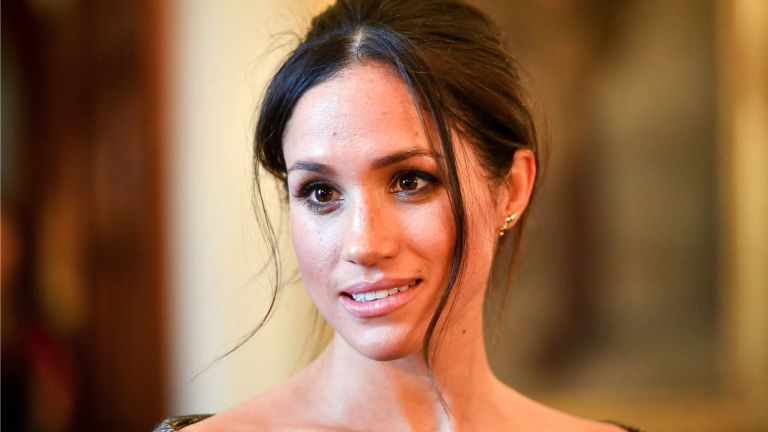 Meghan Markle chats with people inside the Drawing Room during a visit to Cardiff Castle on January 18, 2018 in Cardiff