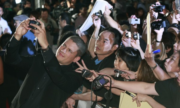 Actor Wentworth Miller takes a photo with fans during the world premiere of
