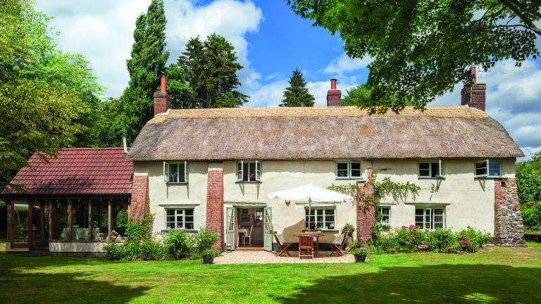 thatched home in summer