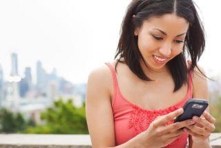 girl sending a text message on her cellphone