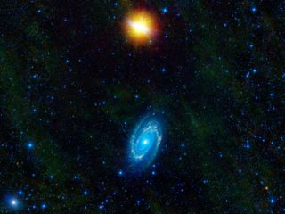 This image from NASA's WISE telescope features the galaxies Messier 81 and Messier 82, which swept by each other a few hundred million years ago, and will likely continue to twirl around each other before eventually merging into a single galaxy.
