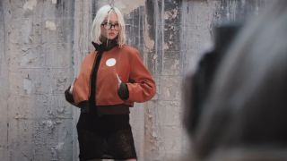 A woman modelling Kim's jacket from Disco Elysium