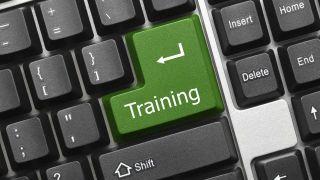 "Closeup of keyboard with large green enter key ""Training"""