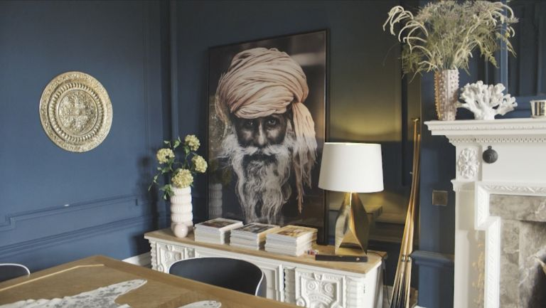 large artwork in Amy Wilsons home on a sideboard in the blue dining room