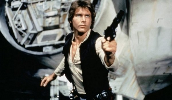 Star Wars A New Hope Harrison Ford Solo poses with a gun next to the Falcon