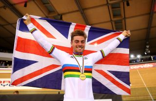 onathan Dibben of Great Britain celebrates his gold medal after winning the final of the Mens Points Race