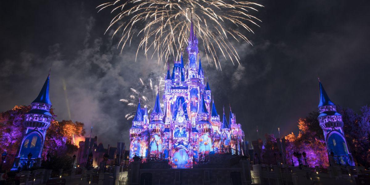 Fireworks explode above a castle at Disney.