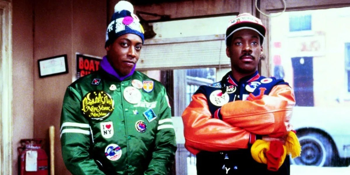 Arsenio Hall and Eddie Murphy as Semmi and Akeem in Coming to America
