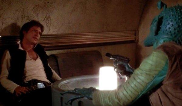 Star Wars Greedo aims his gun at Han in the cantina