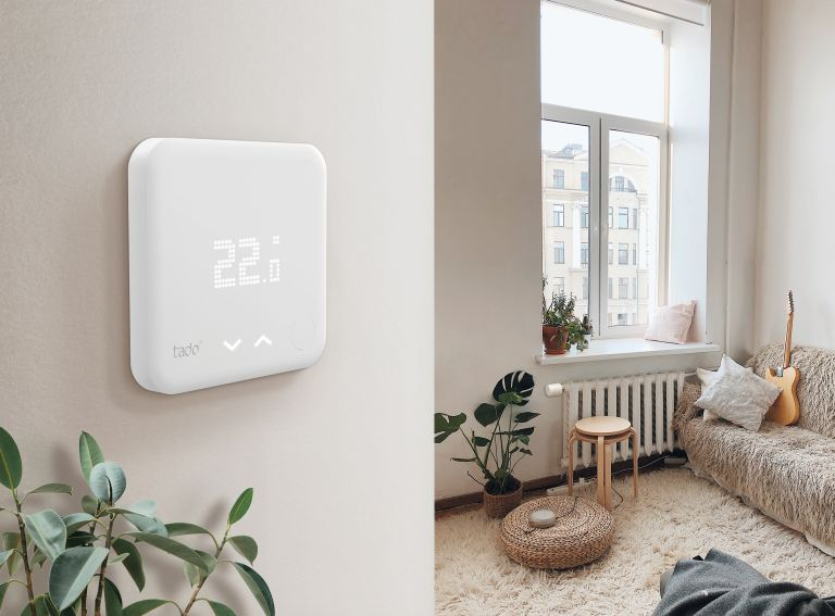 Best energy supplier: Tado smart thermostat on wall in living room