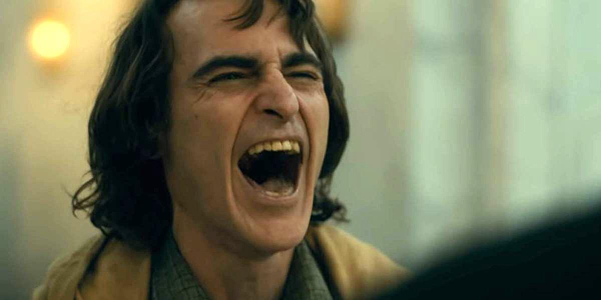Joaquin Phoenix laughing in Joker