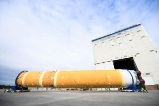 The 212-foot (65 meters) core stage of NASA's new megarocket, the Space Launch System, rolls out of the Michoud Assembly Building in New Orleans, Louisiana on Jan. 1, 2020 for transport to the Stennis Space Center in Bay St. Louis, Mississippi for a critical test.