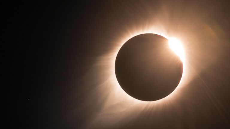 The great North American total eclipse 2017, This is the moment when totality comes to an end and the famous diamond ring is visible, the sun's corona is also still visible with the star Regulus, this is the brightest star in the constellation of Leo and one of the brightest stars in the night sky, lying approximately 79 light years from the Sun (just to the left of the eclipse)—mercury retrograde shadow period 2021