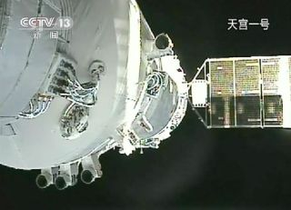Video still showing China's Shenzhou 8 spacecraft docked with the Tiangong 1 lab module on Nov. 3, 2011.