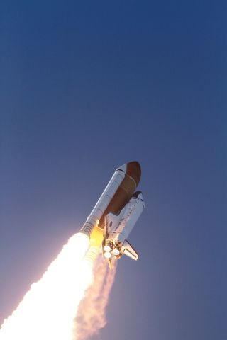 Space shuttle Discovery heads to space after lifting off from Launch Pad 39A at NASA's Kennedy Space Center in Florida to begin its final flight to the International Space Station on the STS-133 mission.