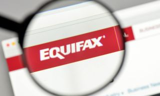 The Equifax logo under a magnifying glass.