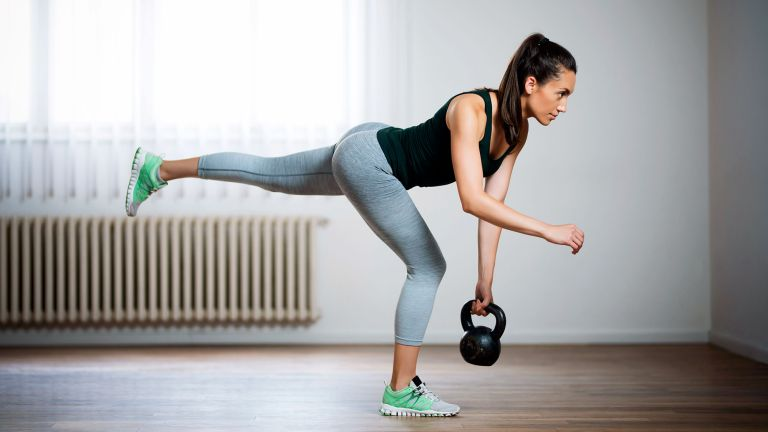 Woman doing the 30-day killer curves workout challenge