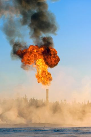 Waste gas is flared, or burnt off, during oil production, as shown above. This is process emits carbon dioxide, the most prominent greenhouse gas.