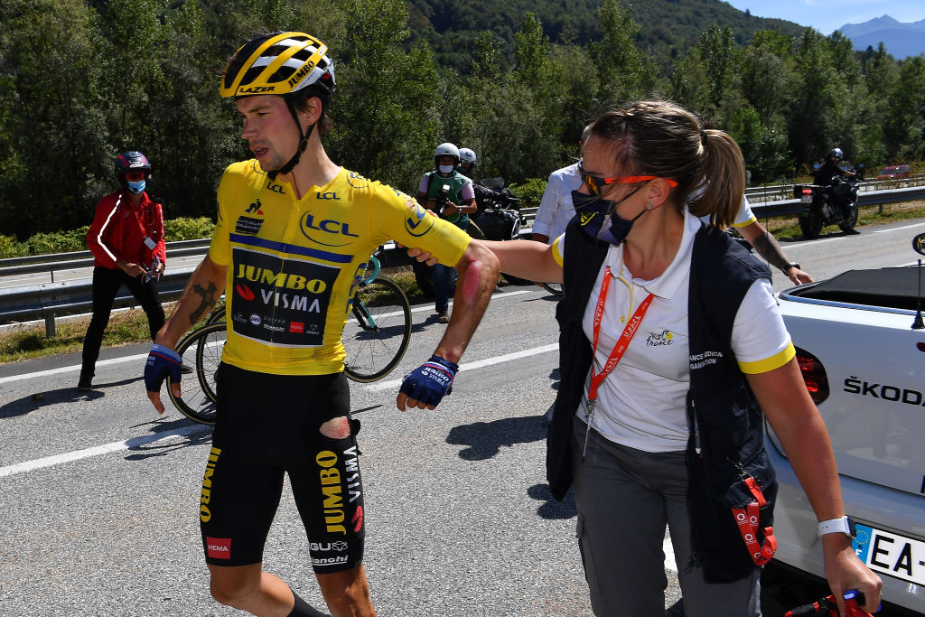 Primoz Roglic is checked by the race doctor