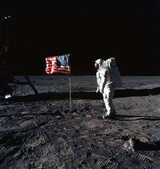 NASA astronaut Buzz Aldrin stands on the moon during the Apollo 11 mission in July 1969.