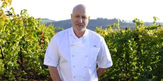 tom colicchio standing in a vineyard on top chef season 18
