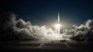 SpaceX will launch two paying passengers on a private flight around the moon in late 2018, the company's founder Elon Musk said Monday, Feb. 27, 2017. The mission would launch on a SpaceX Falcon Heavy seen here in this artist's illustration and take about