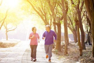 An older couple exercises together