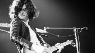 Jimmy Page performs live with Led Zeppelin