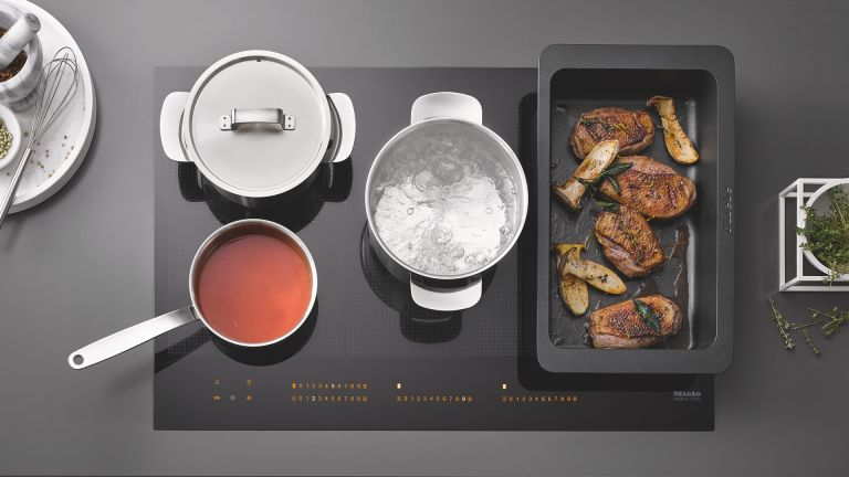 What is an induction hob, and how does it work?