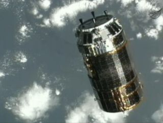 Japan's HTV 3 unmanned cargo spacecraft approaches the International Space Station
