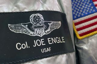 Joe Engle's name tag displays the U.S. Air Force astronaut wings that he earned flying the X-15 rocket plane before flying two space shuttle missions for NASA.