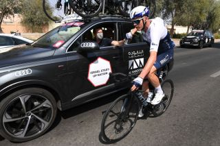 Chris Froome drops back to the team car at the UAE Tour