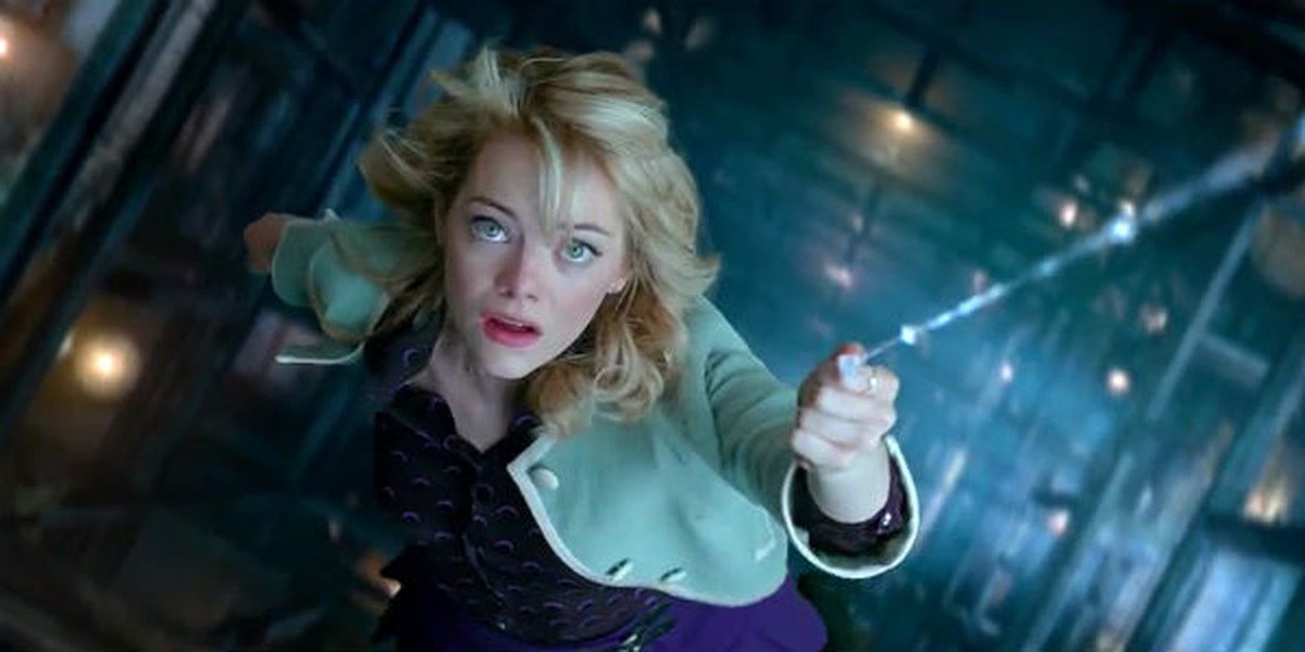 Gwen Stacy (Emma Stone) hangs from a web in The Amazing Spider-Man 2 (2014)