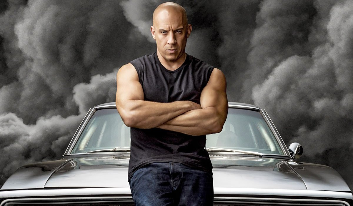 F9 Vin Diesel stands moodily in front of dark clouds