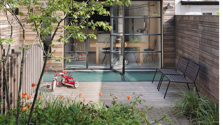 Small garden idea with crittall doors and patio