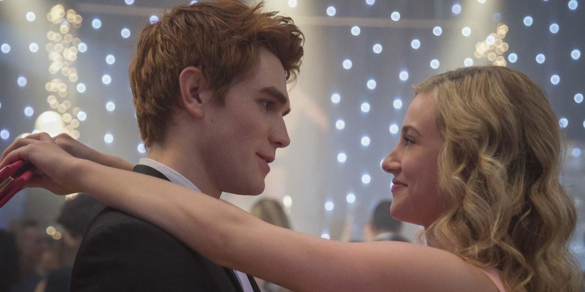 Betty and Archie dancing together in Riverdale.