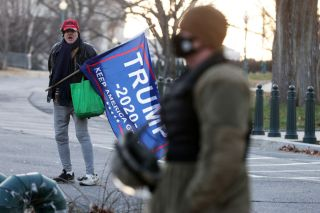 A lone Trump supporter holds a flag outside the U.S. Capitol Jan. 7, 2021 in Washington, DC.