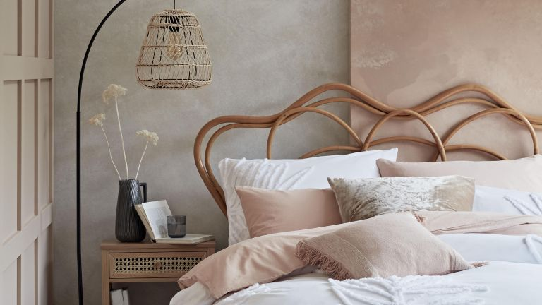 Pink bedroom with concrete effect walls by Habitat
