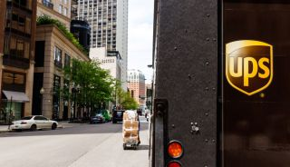 The rear gate of a UPS truck during a delivery run on a Chicago city street.