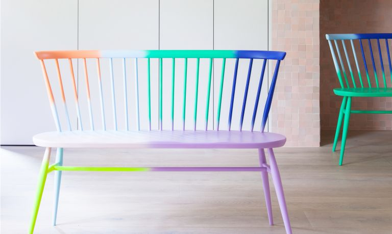 A colourful ercol loveseat designed by 2LG Studio